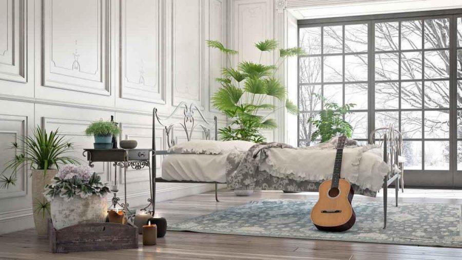Những đường boiserie phức tạp và các chi tiết bằng sắt rèn tinh tế làm cho phòng ngủ đẹp màu trắng
