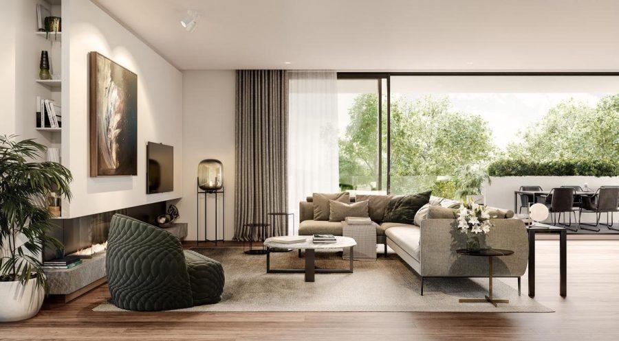 Phòng khách này có một tấm thảm bằng da lộn, một chiếc ghế dài bằng vải lanh và một chiếc ghế màu xám chần bông
