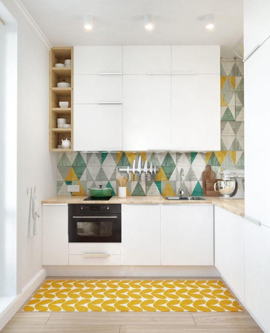 Tủ bếp màu trắng nhẹ nhàng kết hợp với mặt bàn gỗ tự nhiên mang lại cảm giác nhẹ nhàng, thoải mái