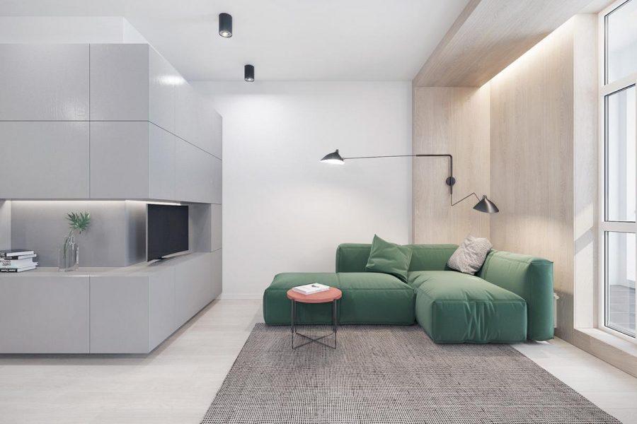 Màu xanh lá cây đậu đánh cắp ánh đèn sân khấu trong căn phòng này, một sự pha trộn tối giản của giá đỡ màu xám, tấm gỗ và đèn di chuột leo