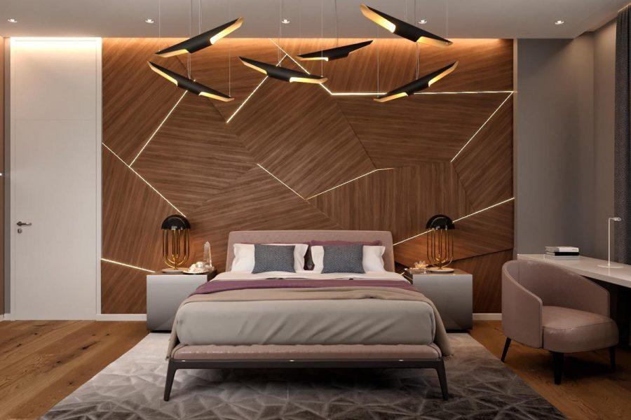 Thiết kế này có tường đầu giường được chiếu sáng, đèn bàn cạnh giường và hệ thống đèn trần trông giống như một tác phẩm nghệ thuật điêu khắc