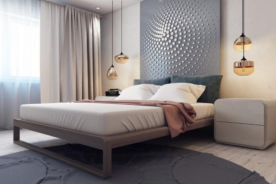 Phòng ngủ này có các vòng tròn đồng tâm xoáy trên đầu giường, một tấm thảm hình tròn trên sàn và đèn mặt dây tròn trên các cạnh giường