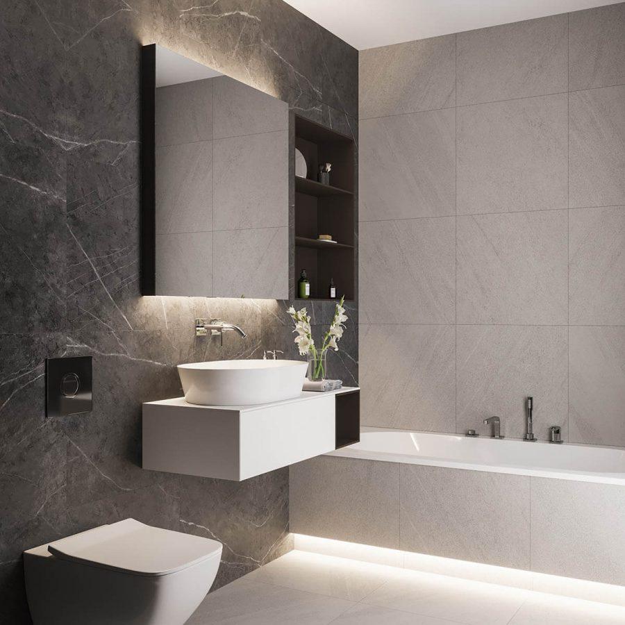 Phòng tắm chủ yếu là gạch đá cẩm thạch màu xám than, kết hợp với một chút màu xám trông nhẹ nhàng hơn