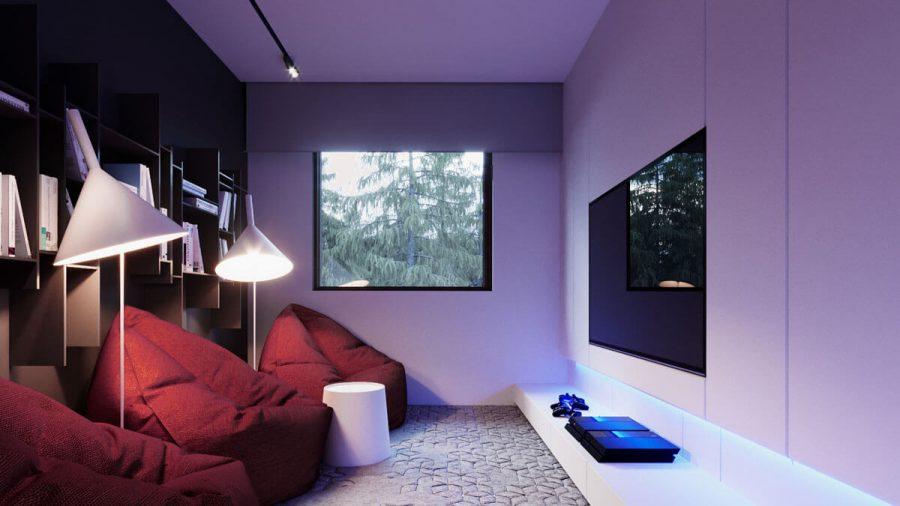 Phòng giải trí kết hợp với kệ sách gỗ đằng sau vô cùng tiện ích khi bạn muốn đọc một quyển sách nào đó