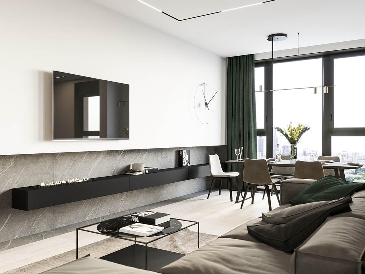 Một chiếc đồng hồ treo tường lớn tạo thêm sự thú vị cho khoảng không gian nhạt màu của bức tường
