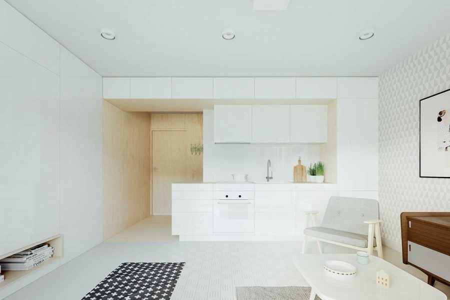 Một mặt của căn phòng nổi bật với giấy dán tường in hình đồ họa mát mẻ và mặt còn lại tỏa sáng rực rỡ với tấm ốp trắng bóng