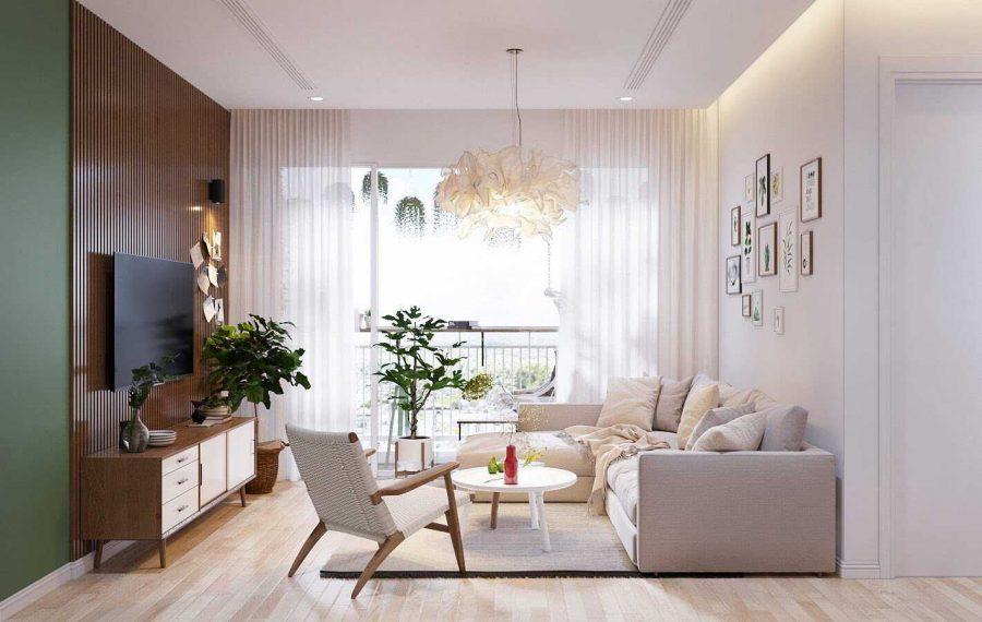 Phòng khách đơn giản với bộ sofa màu kem áp tường rất gọn gàng, kết hợp với một chiếc ghế nhỏ cùng bàn trà hình tròn trông đẹp mắt