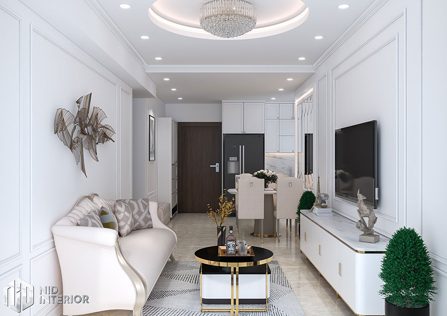 Phòng khách căn hộ với tông màu trắng sáng kết hợp màu vàng đồng vô cùng sang trọng