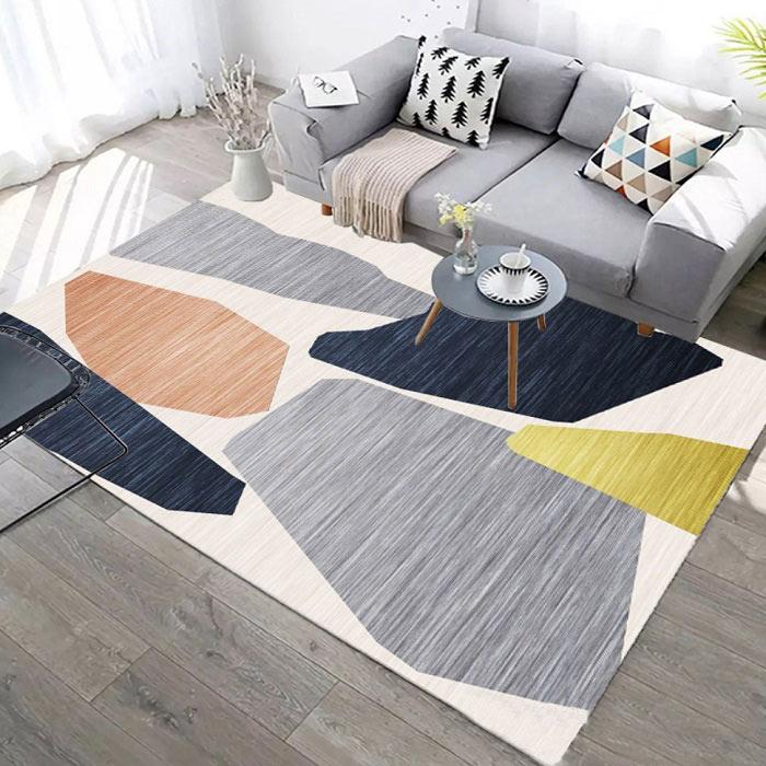 Kết hợp màu vàng và xám trên thảm và gối tựa sofa phòng khách.