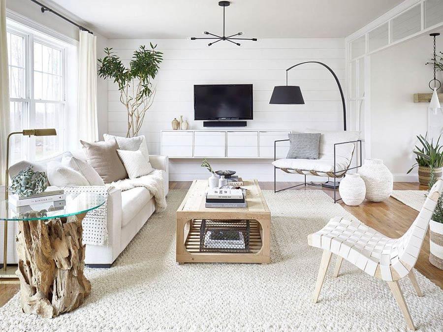 Phòng khách hiện đại với màu trắng và gỗ thêm một chút ánh sáng tự nhiên.